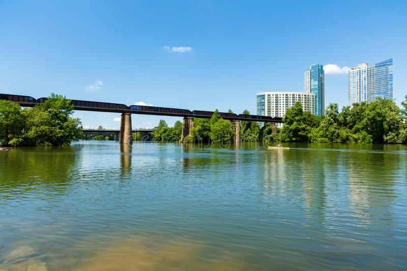 Downtown Austin Skyline. Skyline view of downtown Austin, Texas with the Colorado River and kayaker cruising by stock image