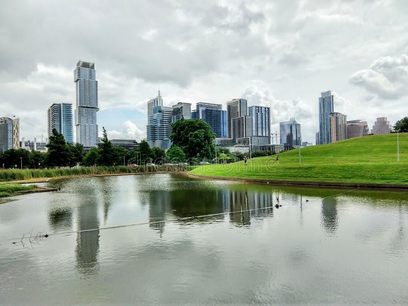 Downtown Austin Texas. Water, reflection, modern, building, skyscrapers, city, urban royalty free stock photos