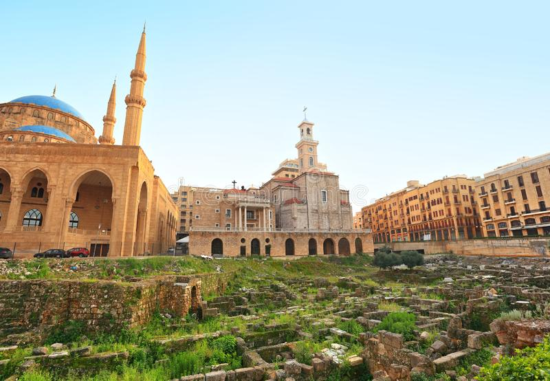 Downtown Beirut Skyline with Roman Ruins. Downtown Beirut, Coexistence with mosque, church, buildings and Ancient Roman Ruins stock images