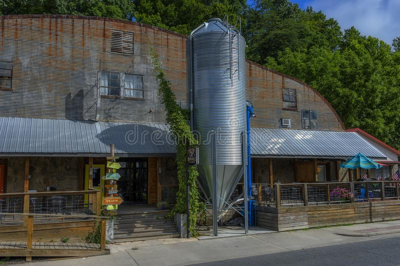 Downtown Bryson, North Carolina, USA. Bryson, North Carolina, USA - August 3, 2019:  An old building with shops and restaurant in Bryson, seen from a moving royalty free stock image