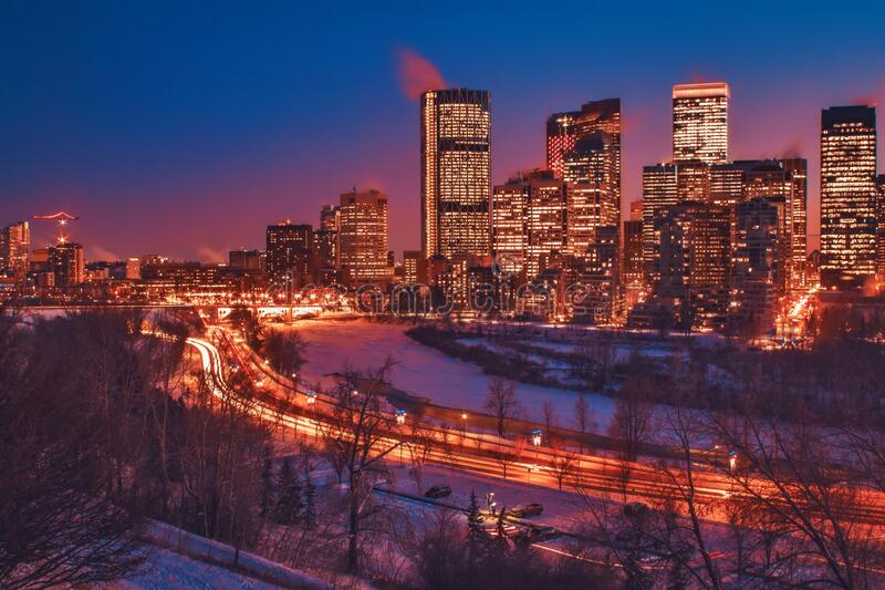 Downtown Calgary Illuminated At Night. A vibrant view of lights and buildings illuminated at night in downtown Calgary royalty free stock photos