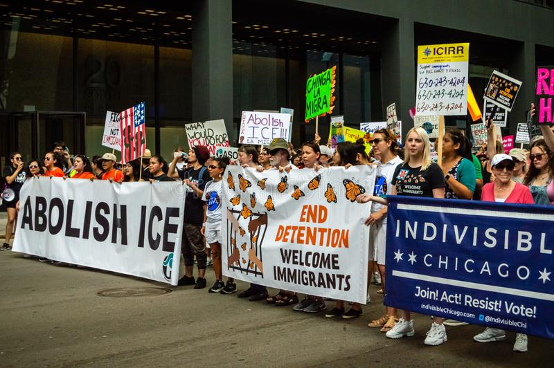 Protest against ICE. Front line marchers with banners supporting immigration stock images