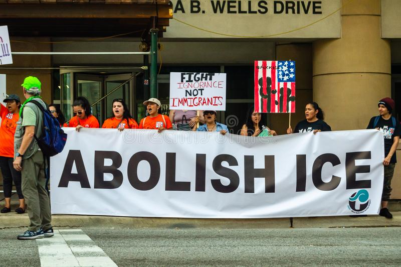 Protest against ICE and Customs and Border Patrol Detention Centers. Group with `Abolish ICE` banner. Downtown, Chicago-July 13, 2019: Protest against ICE and royalty free stock image