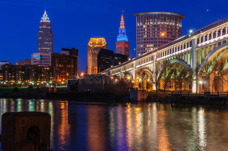 Downtown Cleveland Skyline. The Terminal Tower, Key Bank and BP building shine against the night sky in downtown Cleveland as the Cuyahoga River rolls past. The stock photography
