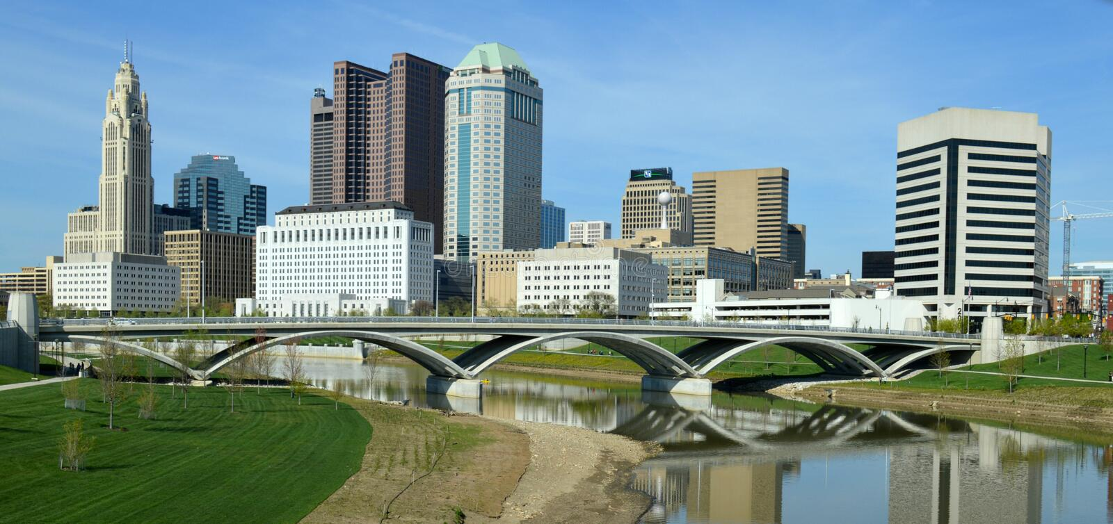 Downtown Columbus Ohio Skyline Rich Street Bridge. A view of downtown Columbus, Ohio, The Rich Street Bridge, and their reflections in the Scioto River stock image