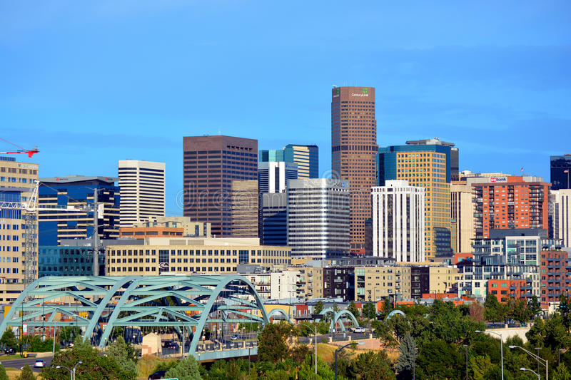 Downtown Denver, Colorado Skyscrapers with Confluence Park and the Speer Blvd. Platte River Bridges in the Foreground royalty free stock image