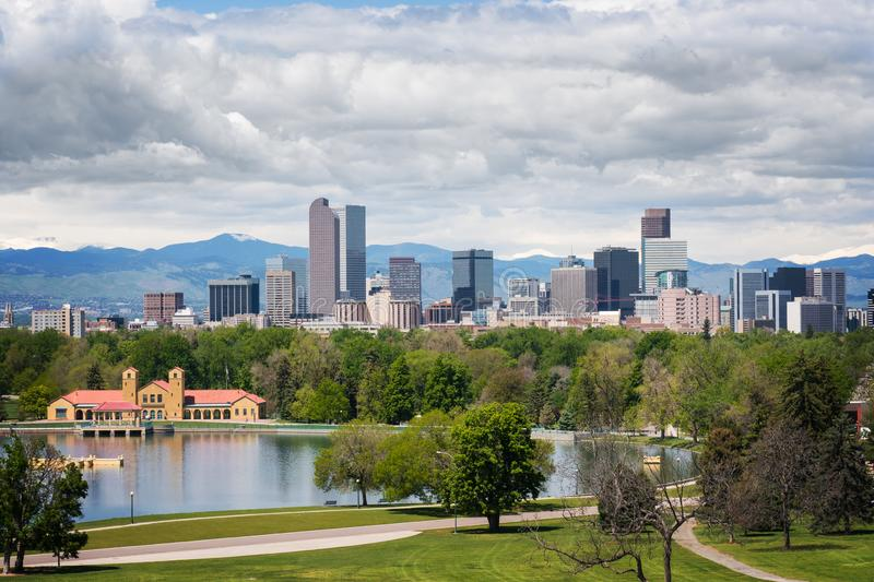 Downtown Denver Skyline with City Park and Clouds. Downtown Denver skyline, as seen from City Park, on a cloudy day, with Rocky Mountains in the background stock photo