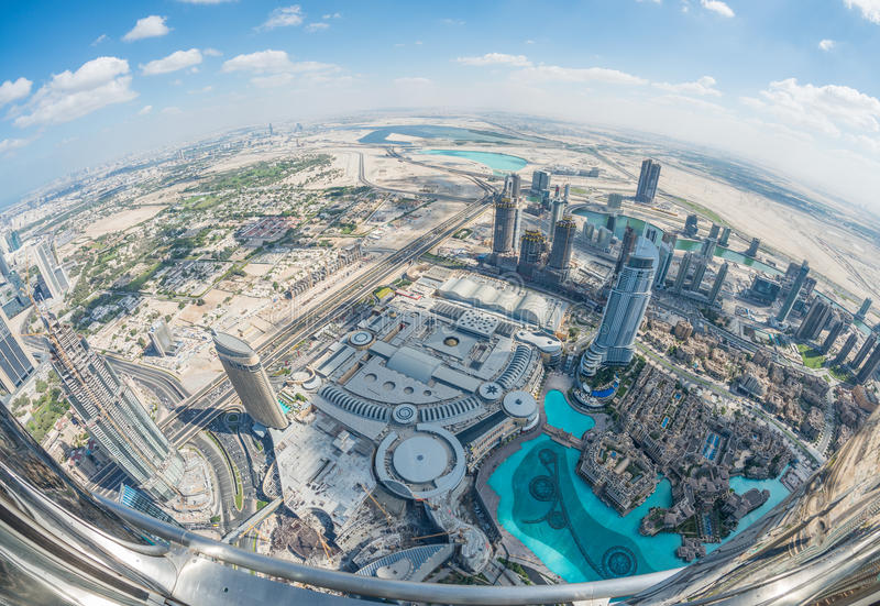Downtown Dubai and artificial lakes - Aerial view with fisheye l stock photos