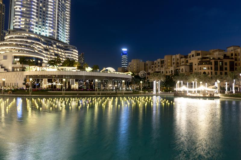 Downtown, Dubai, United Arab Emirates Dubai Fountain Lake Ride tourist attraction, place to visit in uae. With reflecton and illuminated little boats stock images