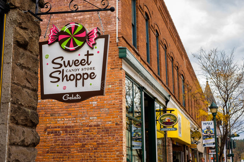 Downtown Flagstaff Cityscape. Flagstaff, AZ USA - October 24, 2016: Cityscape view of colorful storefront signs in the downtown area stock photography