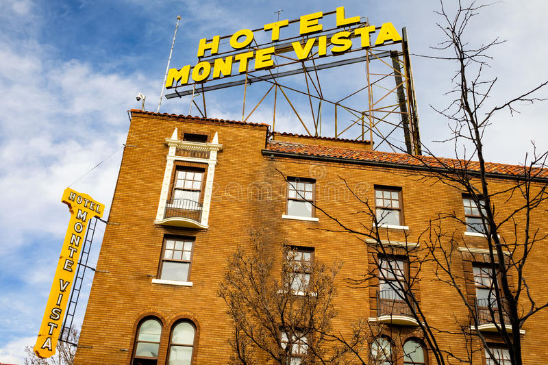 Downtown Flagstaff Cityscape. Flagstaff, AZ USA - October 24, 2016: Cityscape view of the vintage red brick architecture of the historic Hotel Monte Vista in the stock image