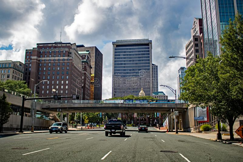 Downtown Hartford, Connecticut Skyline From State Street. Looking west at the downtown Hartford, Connecticut skyline after crossing the Connecticut River on stock photography
