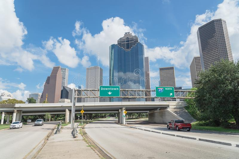Downtown Houston from Allen Parkway under cloud blue sky. Downtown Houston from Allen Parkway near Sabine street under cloud blue sky. Highway/expressway in royalty free stock image