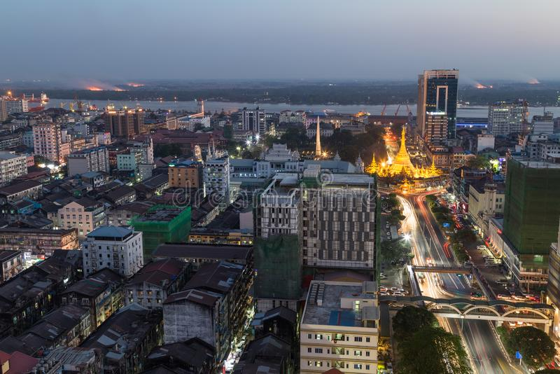 View of downtown Yangon from above at dusk. Downtown and lit Sule Pagoda in Yangon, Myanmar, viewed from above in the evening stock images