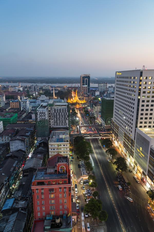 View of downtown Yangon from above at dusk. Downtown and lit Sule Pagoda in Yangon, Myanmar, viewed from above in the evening royalty free stock image