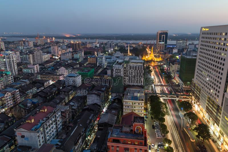 View of downtown Yangon from above at dusk. Downtown and lit Sule Pagoda in Yangon, Myanmar, viewed from above in the evening stock photography