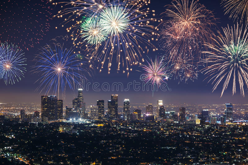 Downtown Los angeles cityscape with fireworks celebrating New Year's Eve. Downtown Los angeles cityscape with flashing fireworks celebrating New Year's Eve stock images