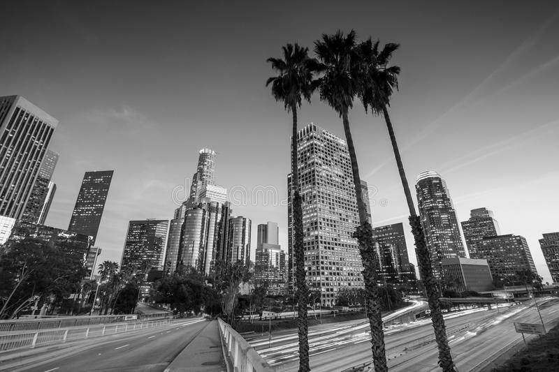 Downtown Los Angeles skyline during rush hour. At sunset, black and white stock photography
