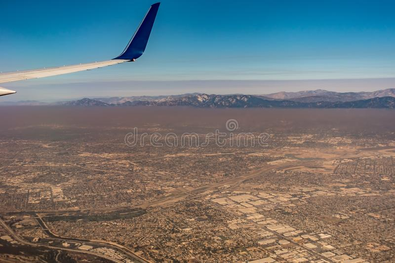 Downtown los angeles skyline and suburbs from airplane and smoke from wild fires. Downtown los angeles skyline  and suburbs from airplane and smoke from wild stock photos