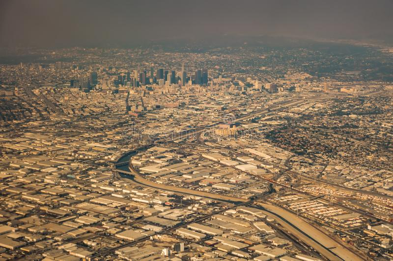 Downtown los angeles skyline and suburbs from airplane and smoke from wild fires. Downtown los angeles skyline and  suburbs from airplane and smoke from wild royalty free stock images