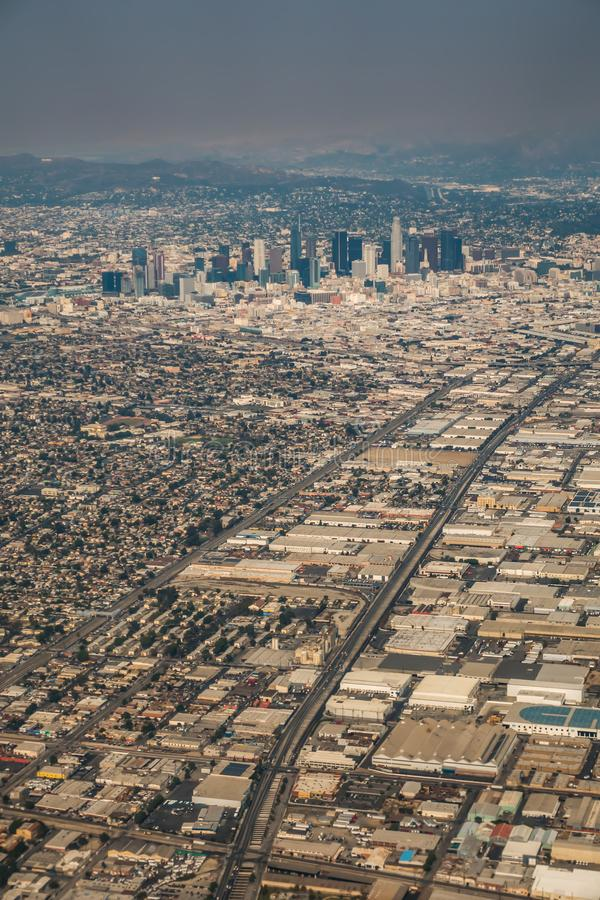 Downtown los angeles skyline and suburbs from airplane and smoke from wild fires. Downtown los angeles  skyline and suburbs from airplane and smoke from wild stock image