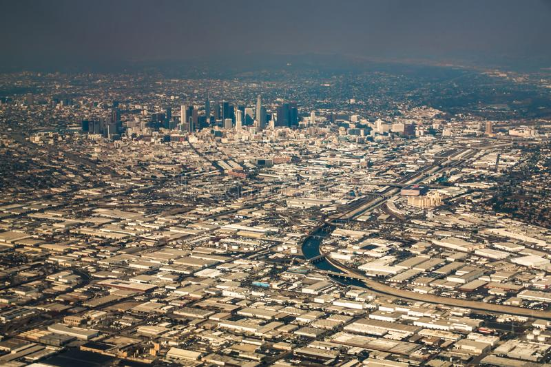 Downtown los angeles skyline and suburbs from airplane and smoke from wild fires. Downtown los angeles skyline and suburbs  from airplane and smoke from wild royalty free stock photos