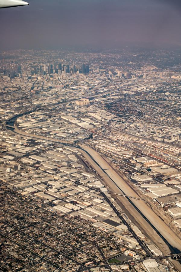 Downtown los angeles skyline and suburbs from airplane and smoke from wild fires. Downtown los angeles skyline and  suburbs from airplane and smoke from wild stock photography