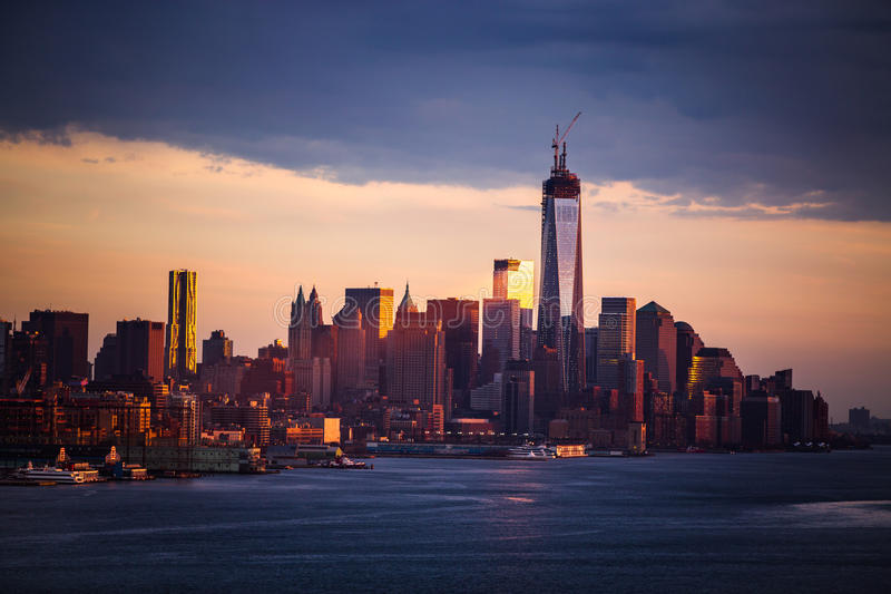 Downtown Manhattan. Across the Hudson River at dusk and One World Trade Center under construction, New York City royalty free stock photos