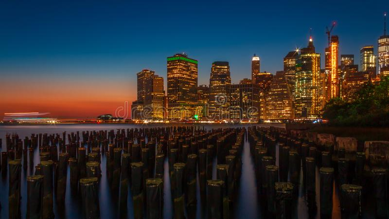 Downtown Manhattan in Blue Hour. Downtown Manhattan viewed from Brooklyn Bridge Park during evening blue hour stock image