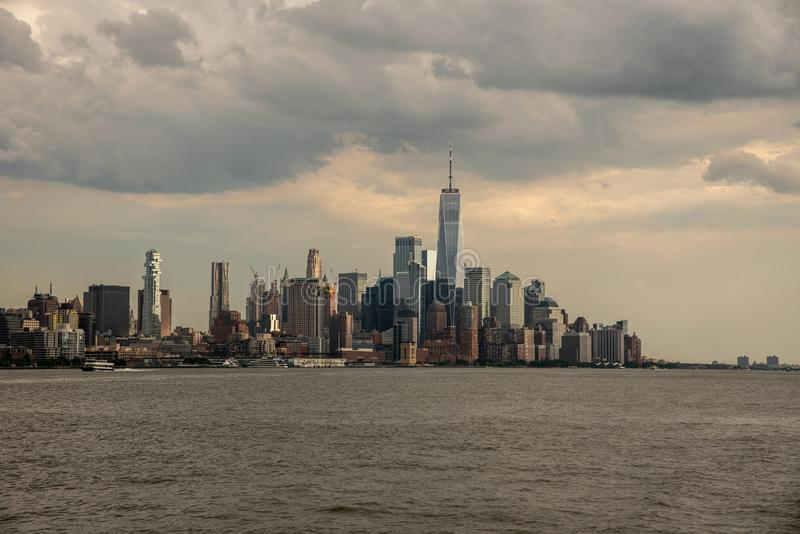 Downtown Manhattan from a boat in the Hudson River. One world trade center in Manhattan with the prominent freedom tower royalty free stock photography