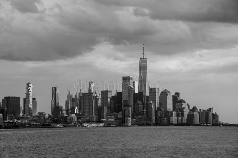 Downtown Manhattan from a boat in the Hudson River. One world trade center in Manhattan with the prominent freedom tower royalty free stock images