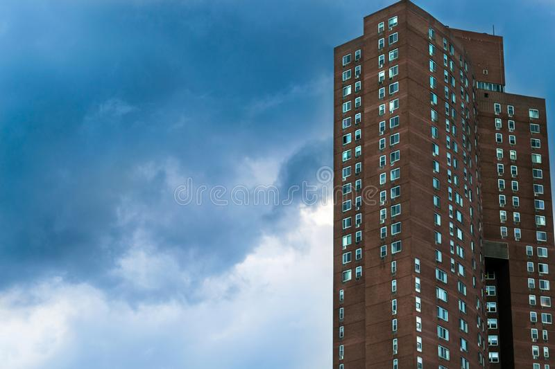 Downtown Manhattan high-rise apartment building on a cloudy and overcast day, Manhattan, New York City, NY. A Downtown Manhattan high-rise apartment building on royalty free stock images