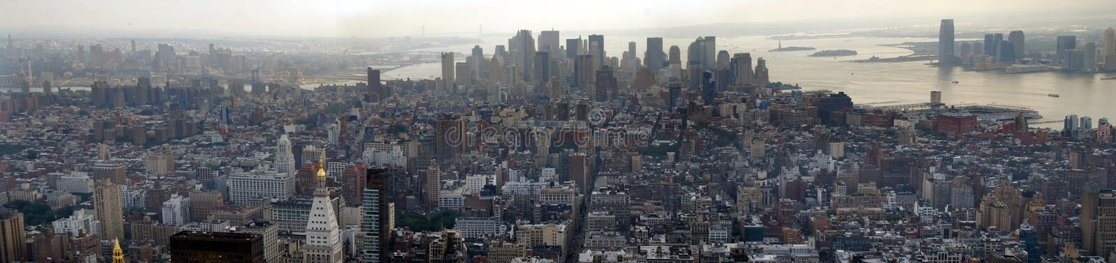 Downtown Manhattan Panoramic. Panoramic view of the downtown of Manhattan on a low grunge and sepia color royalty free stock photos