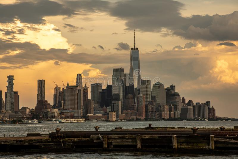 Downtown Manhattan from pier in Hoboken. One world trade center in Manhattan with the prominent freedom tower royalty free stock photography