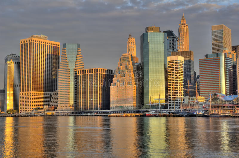 Downtown Manhattan skyline. A striking photograph of a the skyline of downtown Manhattan photographed at sunrise. This is an HDR composite of three exposures royalty free stock images