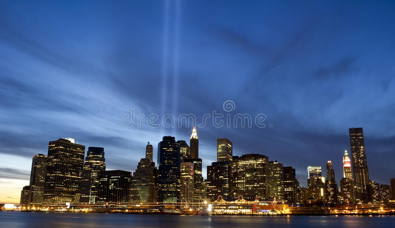 Downtown Manhattan skyline. A striking photograph of a the skyline of downtown Manhattan with dramatic cloud formation and twin-tower light beams stock photo