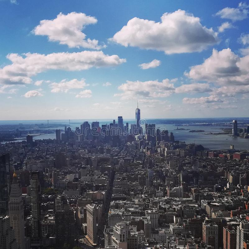Downtown Manhattan. Skyline of Downtown Manhattan from the Emire State Building also shows the Statue of Liberty and the One World Trade Center royalty free stock image