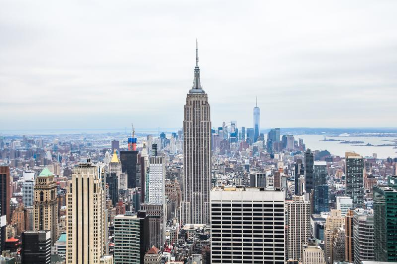 Downtown Manhattan skyline with Empire State Building and midtown skyscrapers, from the Top of the Rock. Winter day royalty free stock image