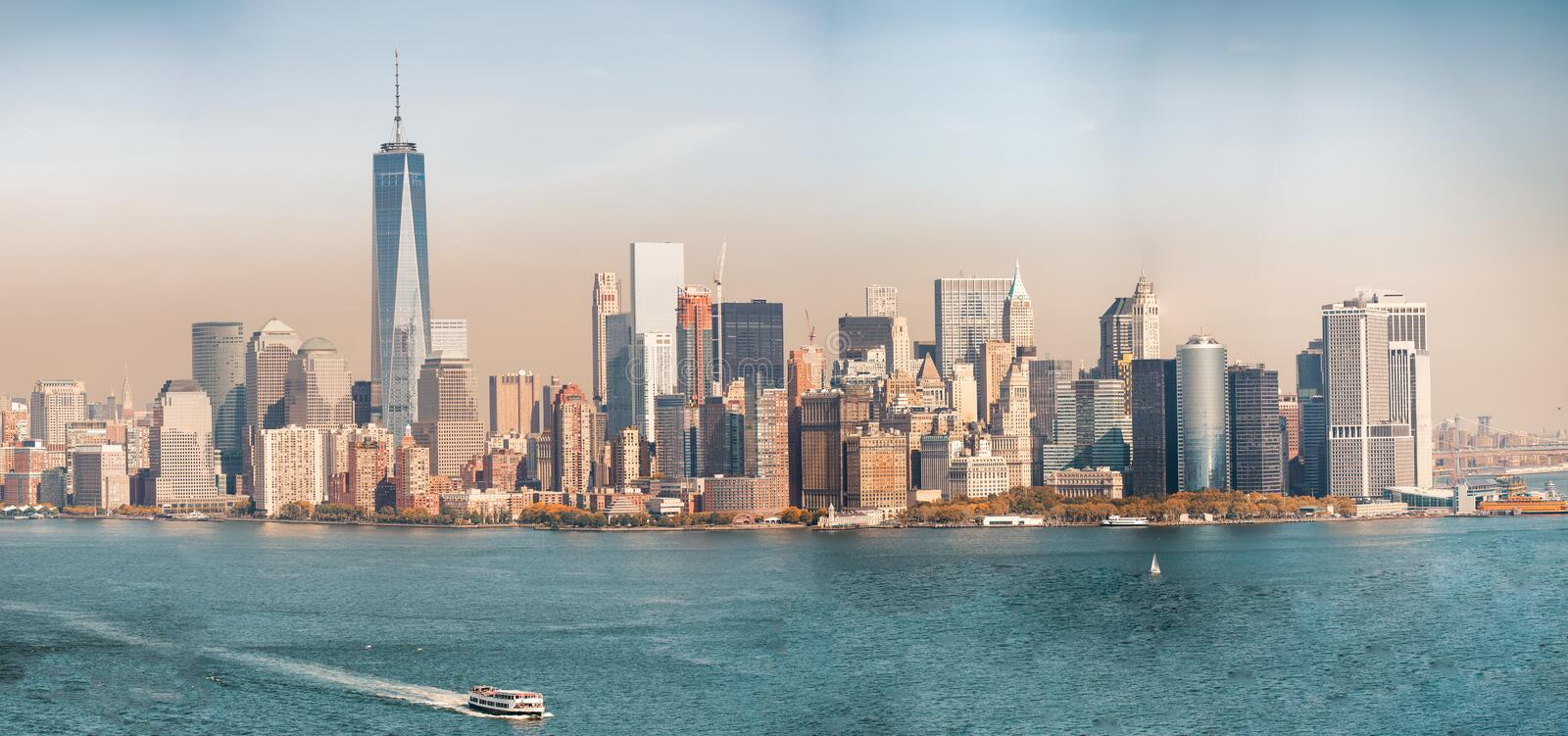 Downtown Manhattan at sunset. Beautiful view from Ellis Island stock photography