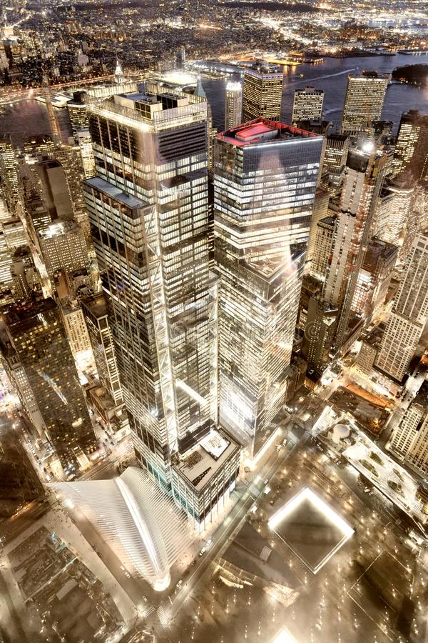 Downtown Manhattan tall skyscrapers, downward view at night, city lights reflections, New York stock photos