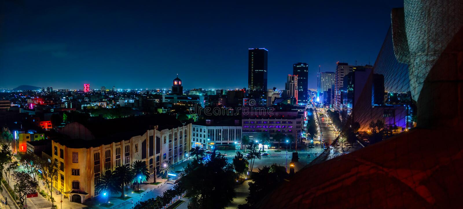 Downtown Mexico City skyline. At night from top of the revolution monument stock photo