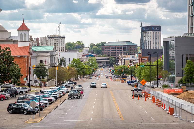 Downtown Montgomery with wide street, car parked and buildings in the background. Montgomery, Alabama. Montgomery, Alabama - April 25th 2014 - Downtown stock image