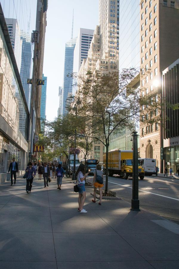 Downtown new york daily street scene in summer. Daily street scene in manhattan new york with glass skyscrapers and the reflection of the afternoon sun royalty free stock photos