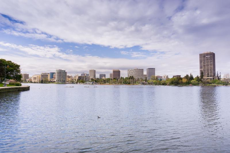 Downtown Oakland as seen from across Lake Merritt on a cloudy spring day, San Francisco bay area, California stock photography