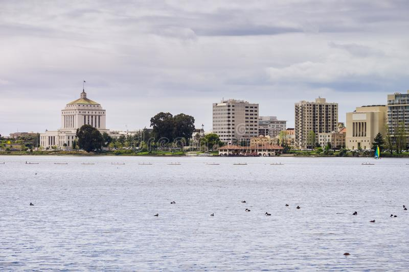 Downtown Oakland as seen from across Lake Merritt on a cloudy spring day, San Francisco bay area, California stock images