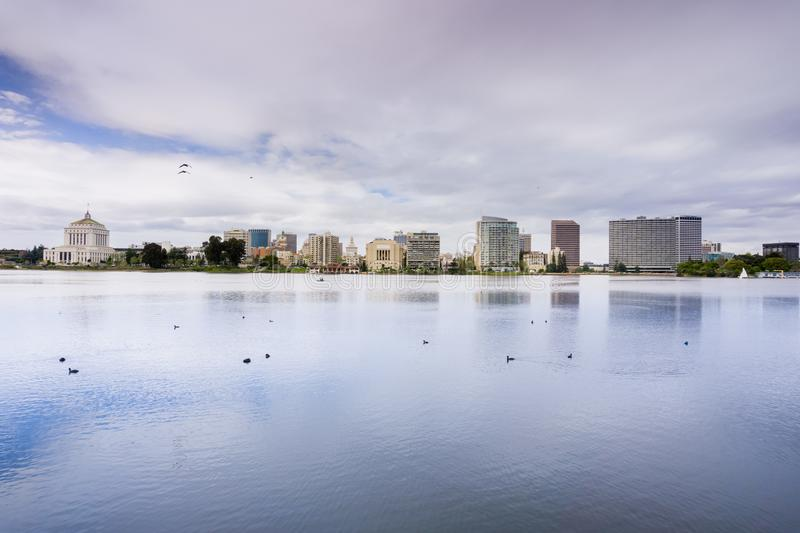 Downtown Oakland as seen from across Lake Merritt on a cloudy spring day, San Francisco bay area, California royalty free stock image