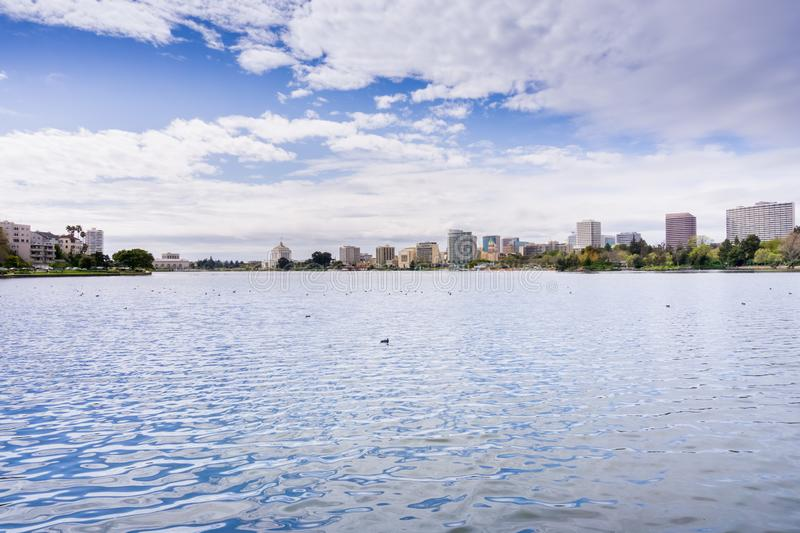 Downtown Oakland as seen from across Lake Merritt on a cloudy spring day, San Francisco bay area, California stock image