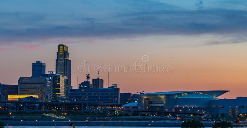 Downtown Omaha at dusk as the sun sets. Photo of the colorful sky over Omaha Nebraska downtown as the sun sets resulting in a rather beautiful and colorful stock photo