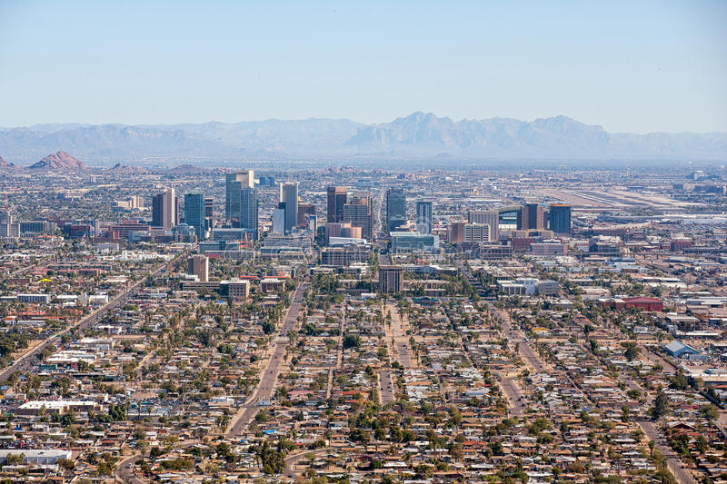 Downtown Phoenix. Aerial view of downtown Phoenix, Arizona looking west to east with the Superstition Mountains in the distance stock images