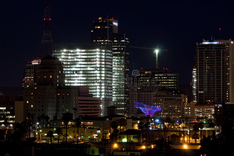 Downtown Phoenix Office Buildings at Night. Busy downtown Phoenix, Arizona, on a Saturday night after dark with lighted signs, streets, modern business buildings royalty free stock images